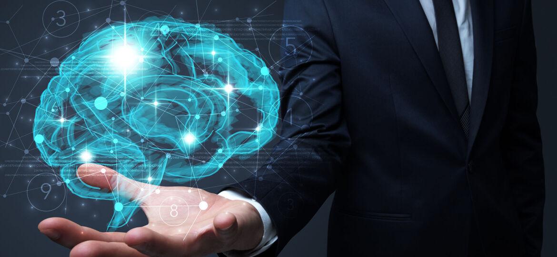 Businessman,Holding,Human,Brain,On,His,Hand,With,Logistics,Symbols